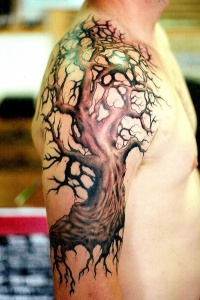 Beautiful colorful tree tattoo on shoulder