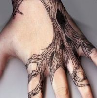 Black tree tattoo on wrist