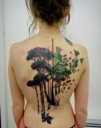 Blak and green geometric tree tattoo on back
