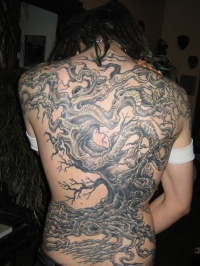 Great black tree tattoo on back